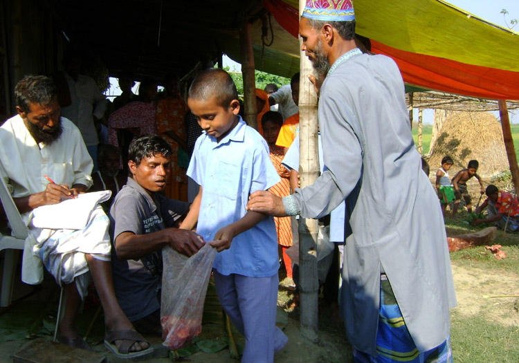 Distribution Of Meat to Orphans & The Poor